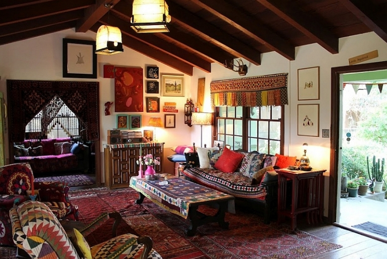 Bohemian-living-room-clad-in-a-wide-variety-of-hues-and-overlapping-rugs