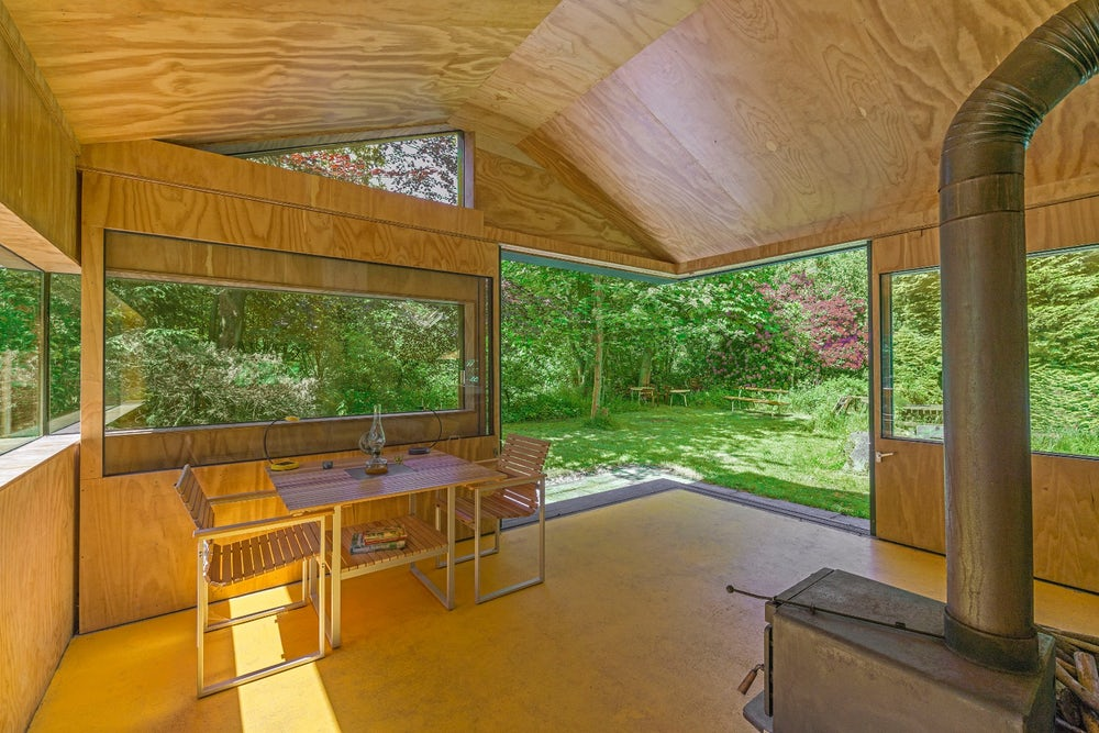 The cabin sports two large sliding doors that open up an entire corner to the outside